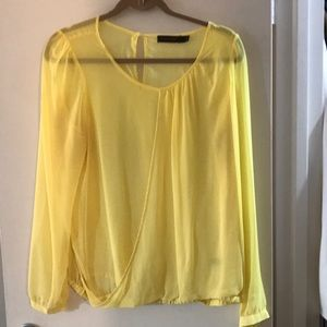 The limited sheer yellow blouse